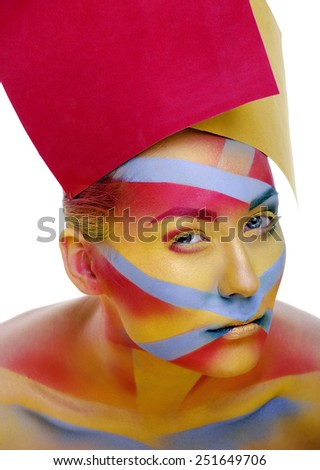 woman with creative geometry make up, red, yellow, blue closeup smiling - stock photo