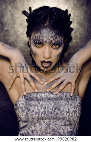 woman with creative make up like snake - stock photo