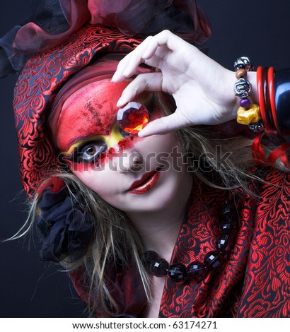 Woman with creative make-up  with strass in her hands - stock photo