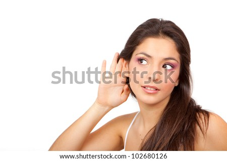 Woman With cupped hand to ear listening to gossip scandal or secrets - stock photo