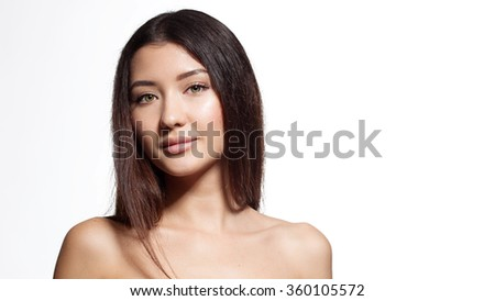 Woman with dark hair and natural make-up with a clear perfect skin and beautiful eyes - stock photo