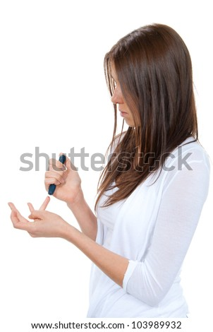 Woman with Diabetes lancet in hand prick finger to make punctures to obtain small blood specimens for blood glucose, hemoglobin level test using glucometer isolated on a white background - stock photo
