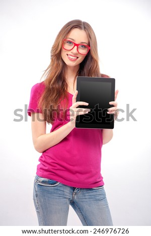 Woman with digital tablet. Cheerful young caucasian woman holding digital tablet and smiling while isolated on white - stock photo