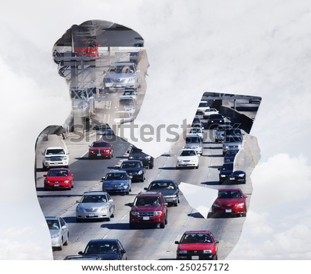 Woman with digital tablet composited with images of traffic  - stock photo