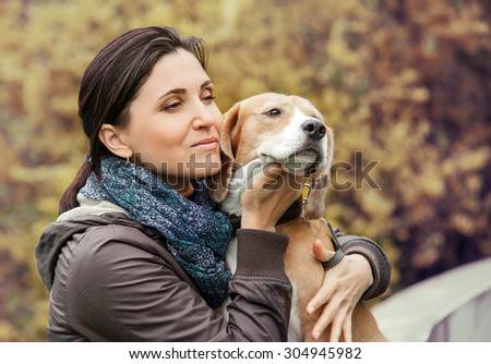Woman with dog portrait - stock photo
