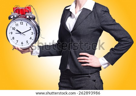 Woman with dynamite and clock on white - stock photo