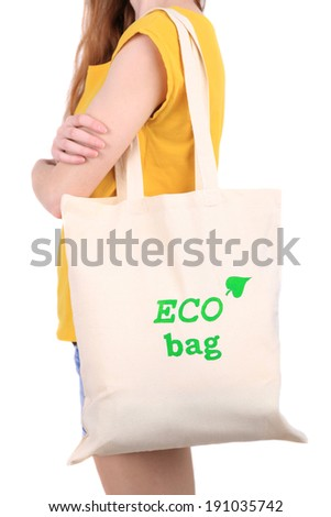Woman with eco bag, isolated on white - stock photo