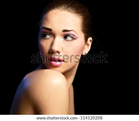 Woman  with exotic style makeup, isolated on black background