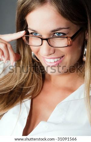 woman with eyeglasses portrait, studio shot - stock photo