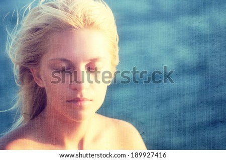 Woman with eyes closed against the sea. Filtered image: vintage, grunge and texture effects - stock photo