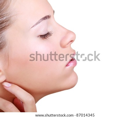 Woman with eyes closed on a white background