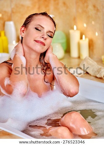 Woman with eyes closed takind home bath. - stock photo