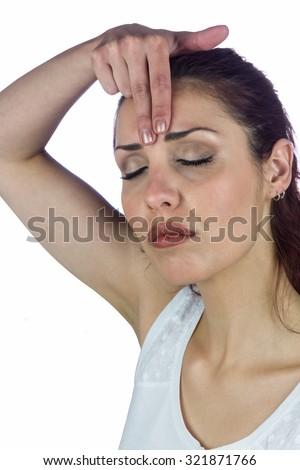 Woman with eyes closed white touching forehead against white background - stock photo