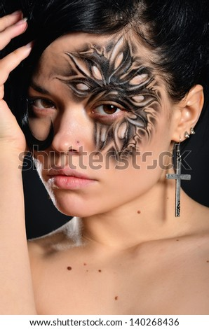 Woman with face-art - stock photo