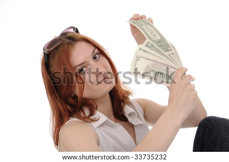 woman with fan of dollars isolated on white - stock photo