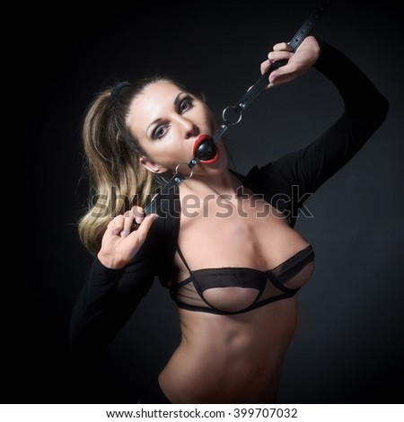 Woman with fetish bdsm gag in her mouth