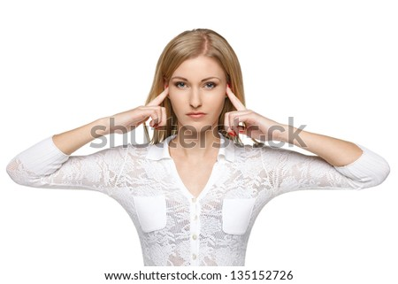 Woman with fingers in ears - stock photo