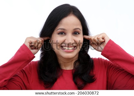 woman with fingers in ears against white - stock photo