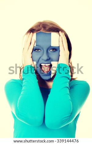 Woman with Finland flag painted on face. - stock photo