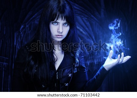 Woman with fire in her hand - stock photo