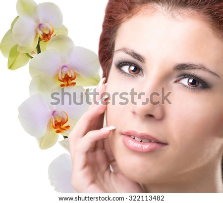 Woman with flower orchid.Face skin care - stock photo