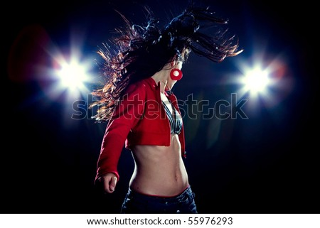 Woman with fluttering hair, with flashes on background