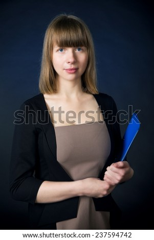 Woman with folder in business suit - stock photo