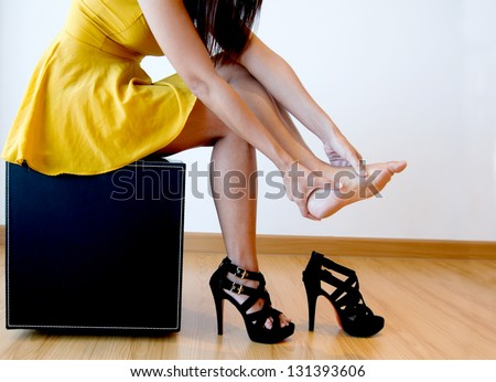 Woman with foot pain - stock photo