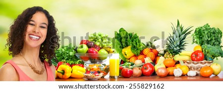 Woman with Fresh fruits and vegetables over green background. - stock photo