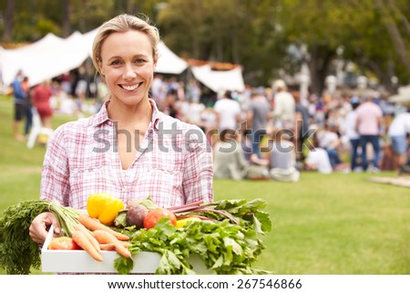 Woman With Fresh Produce Bought At Outdoor Farmers Market - stock photo