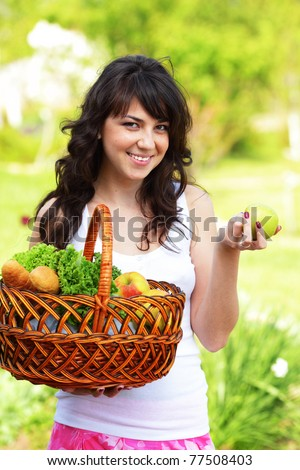 Woman with fruits and vegetables from the garden. Healthy nutrition and diet.