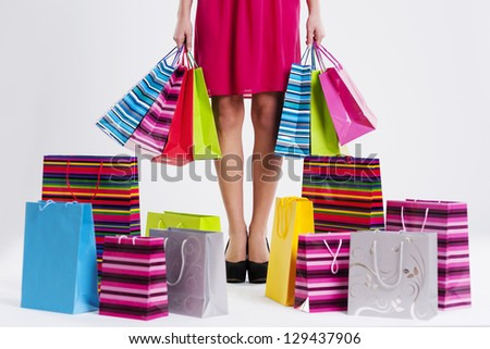 Woman with full shopping bags - stock photo