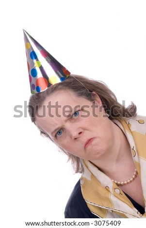 Woman with Funny expression wearing a party hat isolated over blue - stock photo