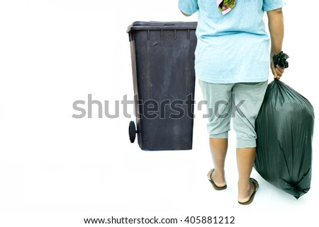 Woman with garbage bag near garbage bin in white background - stock photo