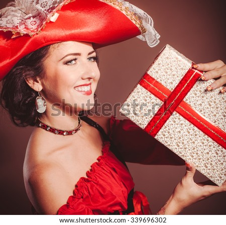 woman with gift box in masquerade costume - stock photo