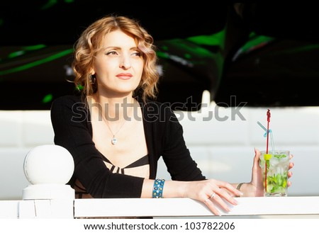 Woman with glass of mojito drink