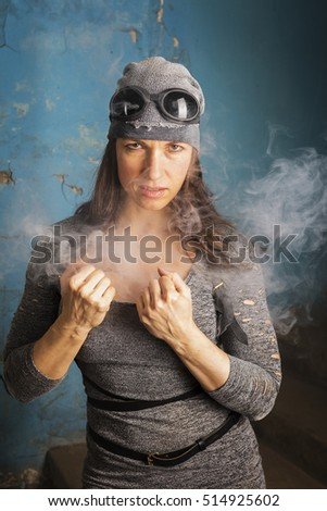 Woman with glasses in smoky boiler room of the old building.