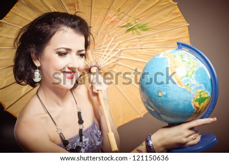 woman with globe in her hands