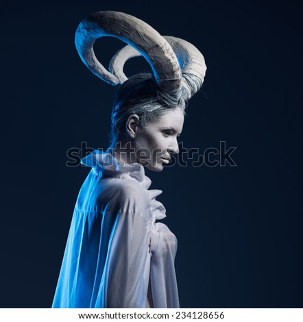 Woman with goat body-art. Chinese Horoscope 2015 - Year of the Goat (Sheep)  - stock photo
