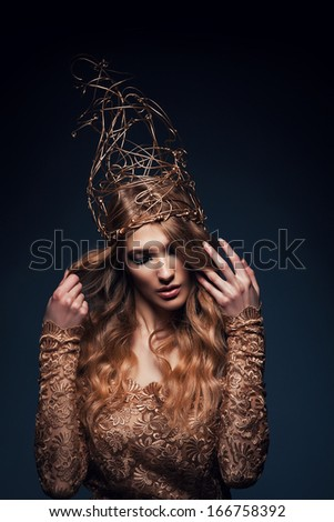 woman with gold accessory on head - stock photo