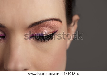 Woman with graphic pink makeup