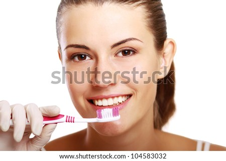 Woman with great teeth holding tooth-brush, isolated on white background - stock photo