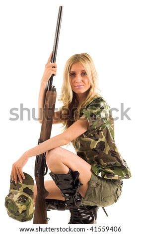 Woman with gun on white isolated