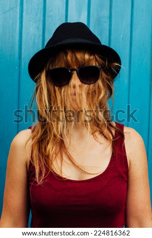 Woman with hair covering her face.