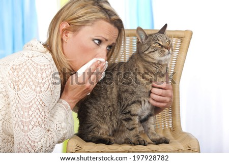 Woman with handkerchief and cat - stock photo