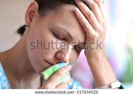 woman with handkerchief having cold with fever - stock photo