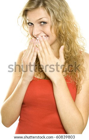 Woman with hands over her mouth laughing. Isolated on white background - stock photo