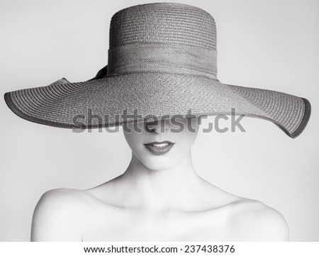 Woman with hat. Studio fashion portrait - stock photo
