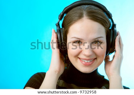 woman with head phones on blue background