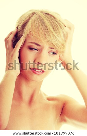 Woman with headache holding her hands to the head